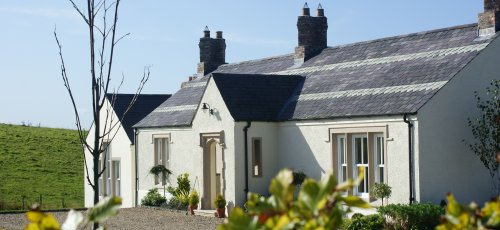 Timeless reclaimed roof slates and bricks by Wilsons Conservation Building Products.