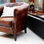 Original cast iron radiator and vintage leather chair