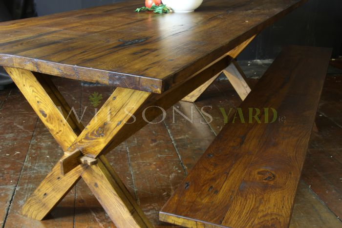 Kitchen / Dining table with axe legs in reclaimed oak