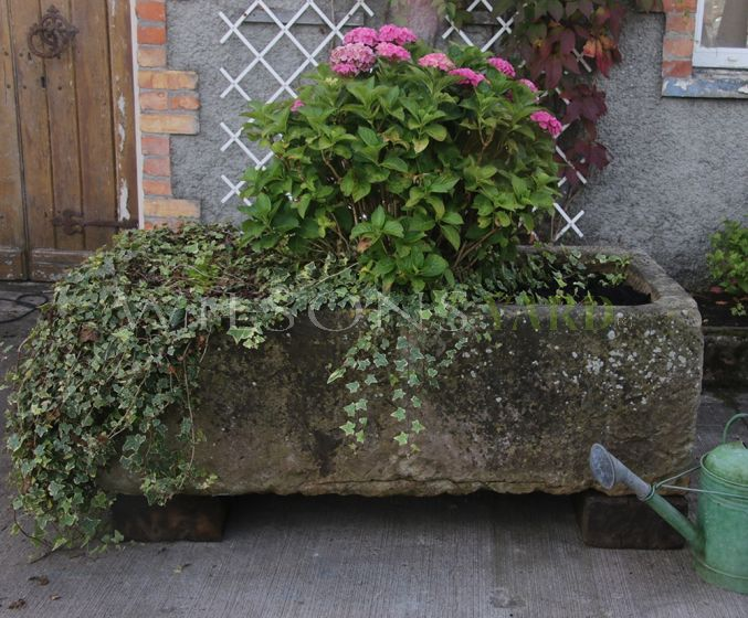Antique garden trough planter