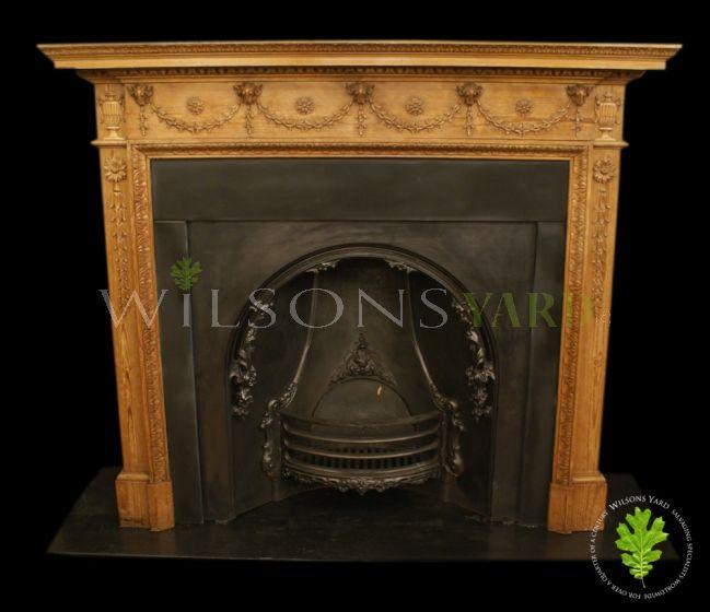 Restored antique wooden fireplace