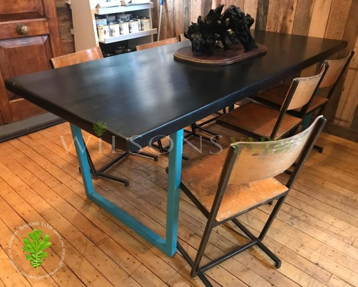 Reclaimed wooden table with metal base