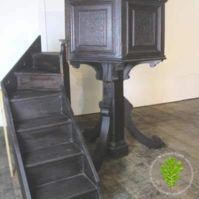 Very tall dark Oak church pulpit