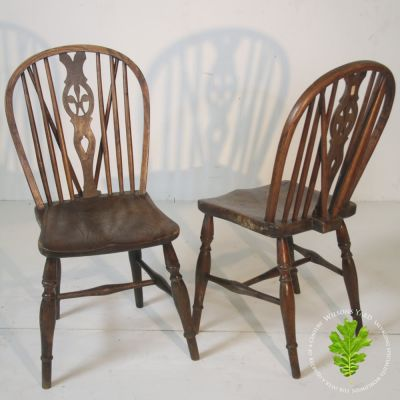 Pair of antique wheel back chairs in Elm