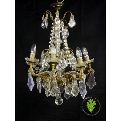 Beautiful medium sized gilded French chandelier.