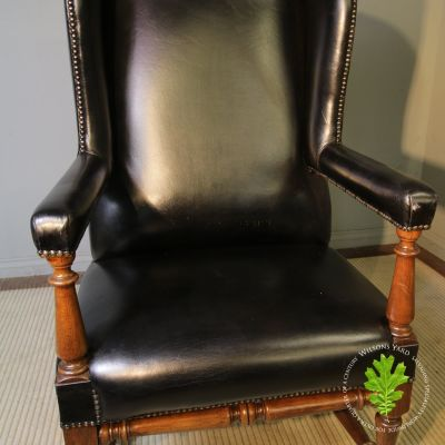 Vintage black wing back chair