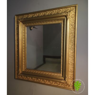 Matching pair of antique mirrors with decorative gilt frame.
