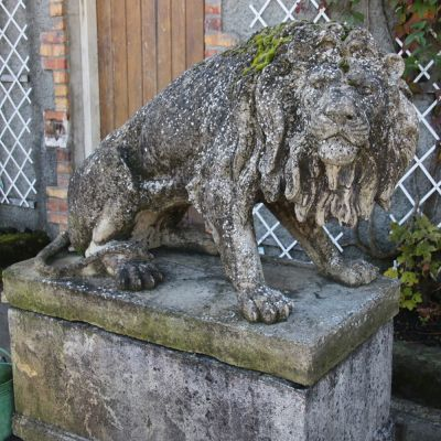 Magnificent recumbent stone lion on plinth