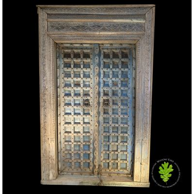 Magnificent hand carved 19th century colonial hardwood door.