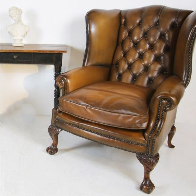 Stunning pair of fine quality wing back leather chairs