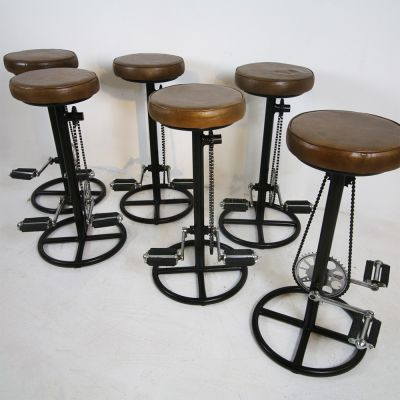Pedal bicycle stools with leather seats