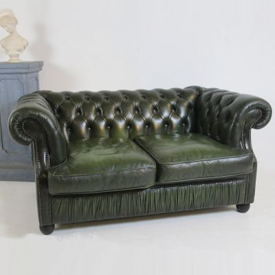 Pretty vintage 2 seater green leather settee