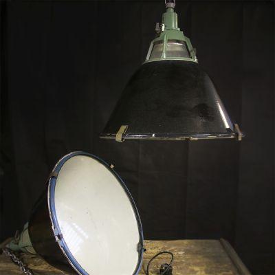 Pair of large black & green industrial lights