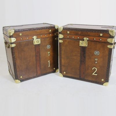 Pair of matching leather travel trunks