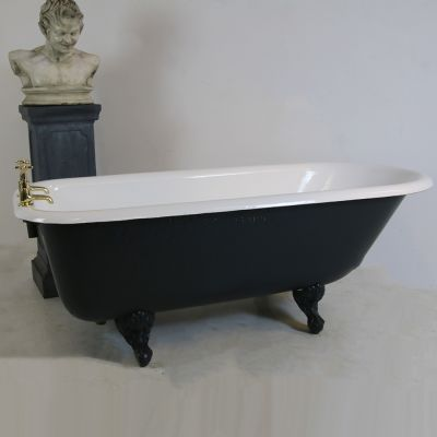 Restored Edwardian roll top bath complete with taps