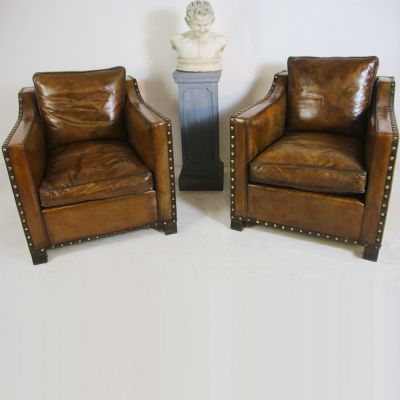 Magnificent pair of vintage howard style leather armchairs