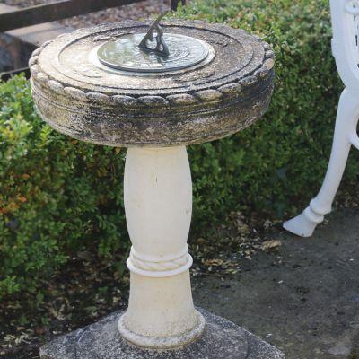 Small stone sundial with bronze sundial