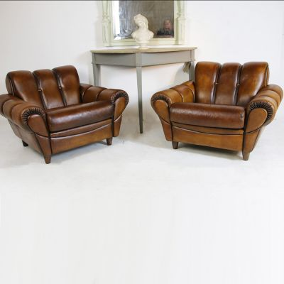 Pair of mid-century leather armchairs
