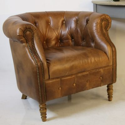 Beautiful vintage tan leather buttoned back club chair