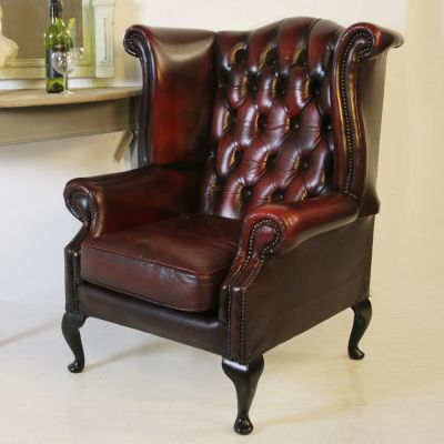 Beautiful red leather button back wing chair
