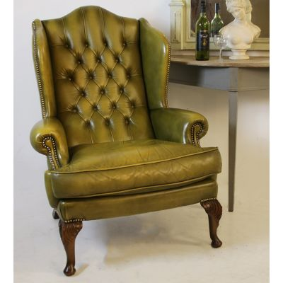 Beautiful Georgian style green leather buttoned backed wing back chair