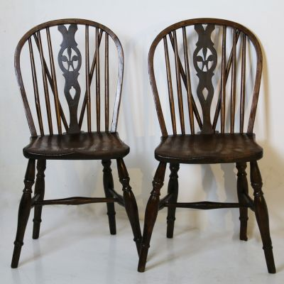 Beautiful pair of antique wheel back chairs