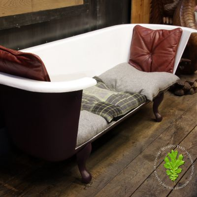 Funky  cast iron bath with claw feet converted into seat with cushions
