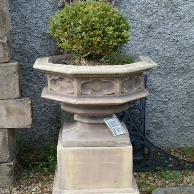 Pair of Gothic Stone Planters on Tall Plinths