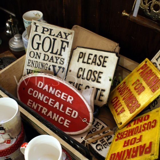 cast iron vintage wall signs