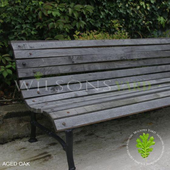 Antique wooden garden bench in aged Oak