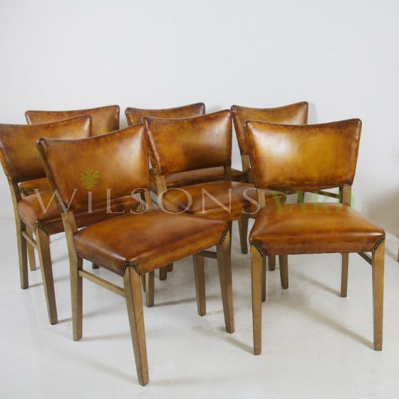 Vintage leather topped dining chairs