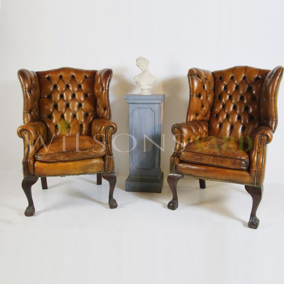 Vintage leather wing back chairs