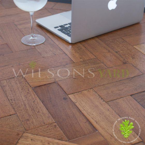 Salvaged wood block herringbone flooring