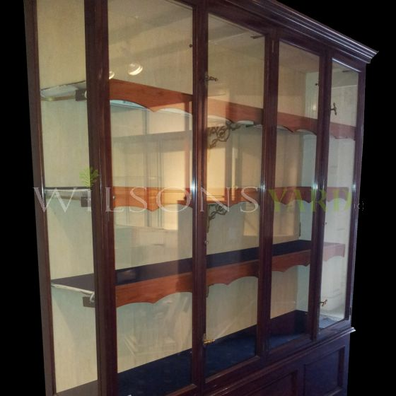 Glazed display cabinet on panelled base