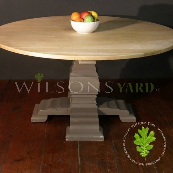 Circular Dining Table with a Reclaimed Oak Top and Decorative Wood Base
